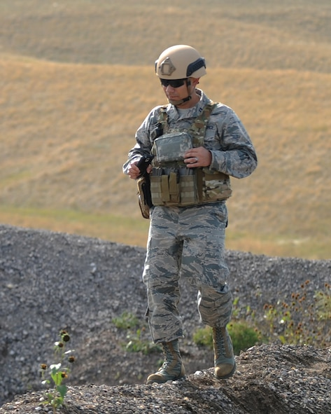Capt. Benjamin Quintanilla, 28th Bomb Wing chaplain, looks around the 28th Civil Engineer Squadron explosive ordnance disposal training site at Ellsworth Air Force Base, S.D., Oct. 6, 2015. As a chaplain, Quintanilla visits squadrons to boost morale and meet with Airmen who may be having a rough time. (U.S. Air Force photo by Airman Sadie Colbert/Released)