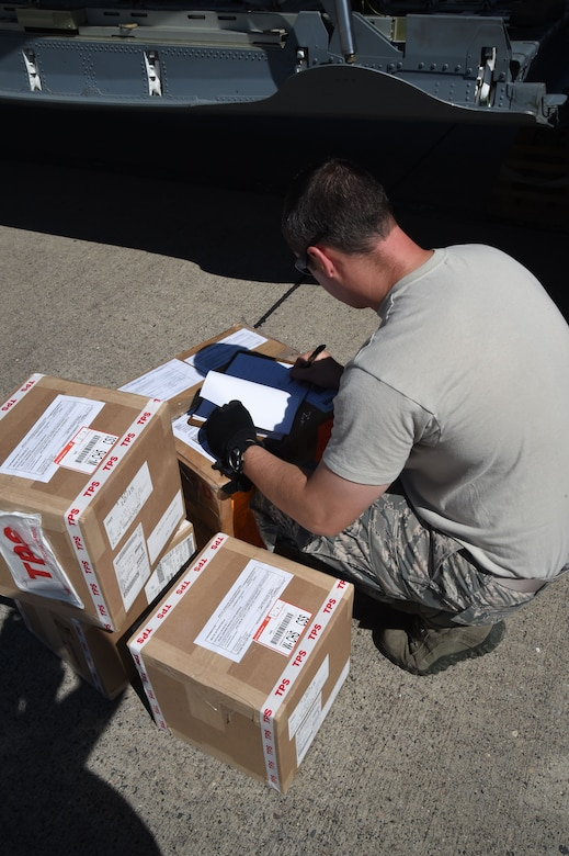 U.S. Air Force Tech. Sgt. Deavin Lee, 612th Air Base Squadron, checks cargo on Soto Cano Air Base, Honduras, Jan. 7, 2016. The cargo  was donated by Helping Hands Ministries and Operations Ukraine and will help many families throughout Honduras. (U.S. Air Force photo by Martin Chahin/Released)
