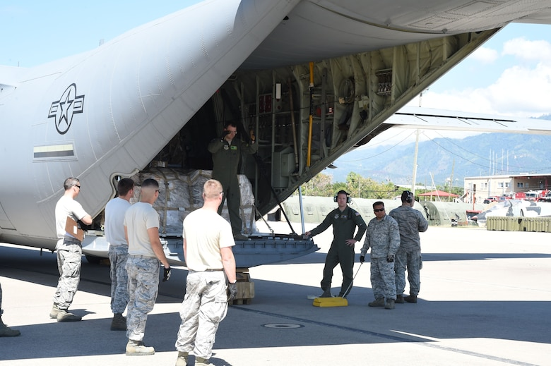 U.S. Air Force members assigned to the 612th Air Base Squadron unload cargo from a U.S. Air Force C-130J Super Hercules cargo aircraft on Soto Cano Air Base, Honduras, Jan. 7, 2016. The 612th routinely facilitates the delivery of cargo delivered through the Denton Program, which allows nonprofit organizations to ship cargo intended for humanitarian aid to remote areas the aircraft are scheduled to visit. (U.S. Air Force photo by Martin Chahin/Released)