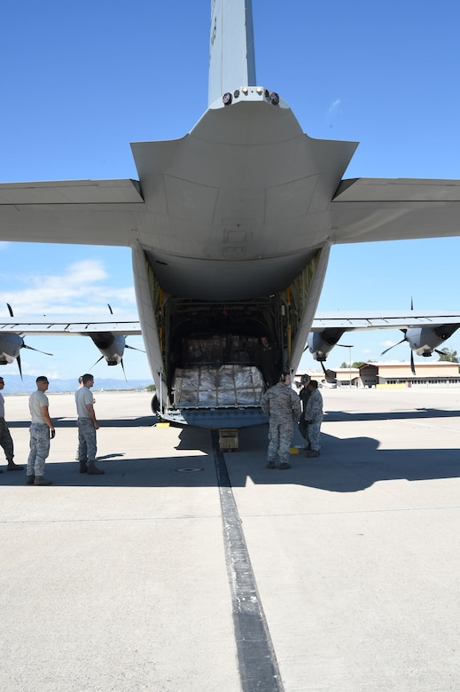 U.S. Air Force members assigned to the 612th Air Base Squadron unload cargo from a U.S. Air Force C-130J Super Hercules cargo aircraft on Soto Cano Air Base, Honduras, Jan. 7, 2016. The cargo was delivered by use of the Denton Program, a program created to allow nonprofit organizations the ability to transport donated humanitarian goods via space available on military cargo aircraft. (U.S. Air Force photo by Martin Chahin/Released)