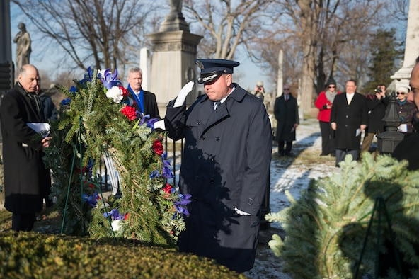 Col. Michael W. Bank Jr., vice commander of the 107th AW at Niagara Falls Air Reserve Station, Niagara Falls, N.Y., renders a salute to President Millard Fillmore, Forest Lawn Cemetery, Buffalo, N.Y., Jan. 7, 2015. Bank presented a wreath on behalf of President Barack Obama to commemorate Fillmore's birthday during a ceremony held by the University at Buffalo.  (U.S. Air National Guard Photo/ Staff Sgt. Ryan Campbell)