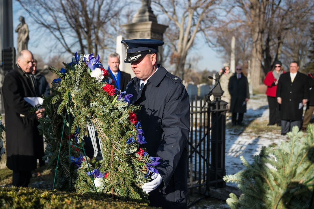 Col. Michael W. Bank Jr., vice commander of the 107th AW at Niagara Falls Air Reserve Station, Niagara Falls, N.Y., lays a wreath at the grave of President Millard Fillmore, Forest Lawn Cemetery, Buffalo, N.Y., Jan. 7, 2015. The ceremony, which is held by the University at Buffalo, commemorates Fillmore's birthday.  (U.S. Air National Guard Photo/ Staff Sgt. Ryan Campbell)