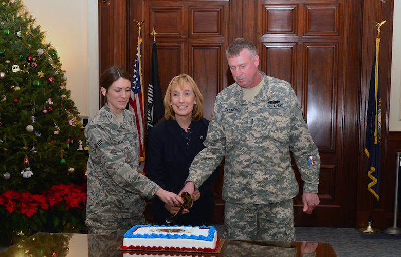 Senior Airman Nikki Healey, New Hampshire Gov. Maggie Hassan, and Chief Warrant Officer 4 David Clemons pose for a photograph marking the 379th anniversary of the National Guard, Dec. 18, 2015, Concord, N.H. Healy, a services technician has been in the N.H. Air National Guard for four years.  (New Hampshire National Guard photo by 1st Sgt. Michael Daigle)