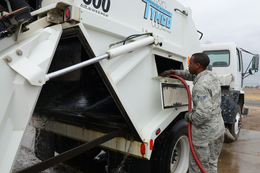Airman 1st Class Demetrius Smith, 56th Civil Engineer Squadron heavy equipment operator, washes a street sweeper at Luke Air Force Base, Ariz., Jan. 5, 2016. Street sweepers are used more often after storms hit the base to help clean the streets. (U.S. Air Force photo by Senior Airman James Hensley)