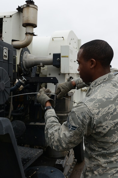 Airman 1st Class Demetrius Smith, 56th Civil Engineer Squadron heavy equipment operator, checks the oil on a street sweeper at Luke Air Force Base, Ariz., Jan. 5, 2016. The street sweepers get utilized primarily for the airfield and secondly for the streets on base. (U.S. Air Force photo by Senior Airman James Hensley)
