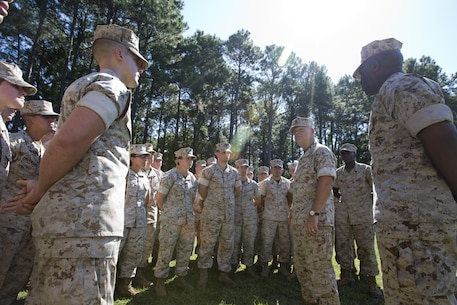 Commandant of the Marine Corps, Gen. Robert B. Neller, center right, and Sgt. Maj. of the Marine Corps Ronald L. Green, right, talk with Marines at Marine Corps Recruit Depot Parris Island, S.C., Oct. 16, 2015. Neller and Green outlined the Corps' current priorities, expectations, listened and answered their questions. (U.S. Marine Corps photo by Sgt. Gabriela Garcia/Released)