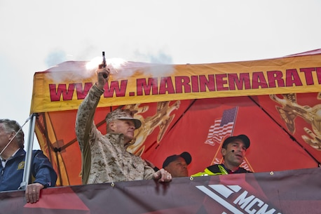 Commandant of the Marine Corps, Gen. Robert B. Neller, fires the starting pistol, initiating the the Marine Corps Marathon at Arlington, Va., Oct. 25, 2015. Over 30,000 runners participated in the 26.2 mile, 40th annual Marine Corps Marathon. (U.S. Marine Corps photo by Sgt. Gabriela Garcia/Released)