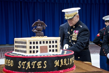 Commandant of the Marine Corps, Gen. Robert B. Neller, cuts a Marine Corps birthday cake during the Pentagon cake cutting ceremony at Washington, D.C., Nov. 9, 2015. The ceremony celebrated the Corps' 240th birthday since it was first established on Nov. 10, 1775. (U.S. Marine Corps photo by Sgt. Gabriela Garcia/Released)