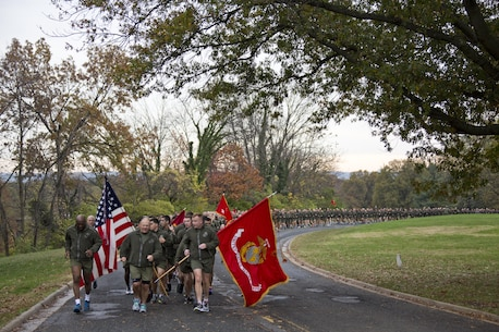 Commandant of the Marine Corps, Gen. Robert B. Neller, center, runs with Sgt. Maj. of the Marine Corps Ronald L. Green, left, Marines and Sailors at Arlington, Va., Nov. 12, 2015. Neller and Green led Marines and Sailors on a Marine Corps birthday run from the Pentagon to the Marine Corps War Memorial. (U.S. Marine Corps photo by Staff Sgt. Gabriela Garcia/Released)