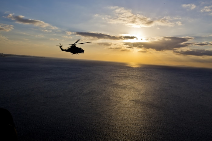 A UH-1Y Huey aircraft with Marine Light Attack Helicopter Squadron 167, flies over Okinawa, Japan, Nov. 23, 2015. The unit supported the Commandant of the Marine Corps, Gen. Robert B. Neller, and Sgt. Maj. of the Marine Corps Ronald L. Green with transportation during their Okinawa visit with Marines. (U.S. Marine Corps photo by Staff Sgt. Gabriela Garcia/Released)