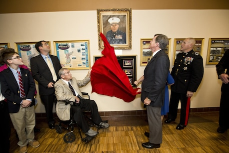 Commandant of the Marine Corps, Gen. Robert B. Neller, right, watches as a the Davis family unveils a portrait at Atlanta, Ga., Dec. 2, 2015. Neller was the guest of honor speaker at retired Gen. Raymond G. Davis's portrait unveiling ceremony inside the Floyd Veterans Memorial Building. (U.S. Marine Corps photo by Staff Sgt. Gabriela Garcia/Released)