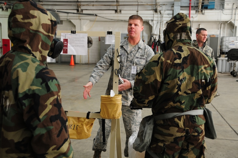 Pennsylvania Air National Guardsman from the 171st Air Refueling Wing practice decontamination training while process are observed by inspectors from Air Mobility Command during the unit's efficiency inspection Oct. 18, 2015 (U.S. Air National Guard Photo by Senior Airman Allyson Manners/Released)