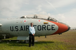 At the Vermont Air National Guard Base, Sept. 3, 2015, Bobby Noble stands in front of the same type of aircraft that his father flew while serving as a pilot in the VTANG. Noble's visit was the first time he had seen the memorials bearing his father's name, who died in a training mission in the early 1980s. (U.S. Air National Guard photo by Staff Sgt. Victoria Greenia)