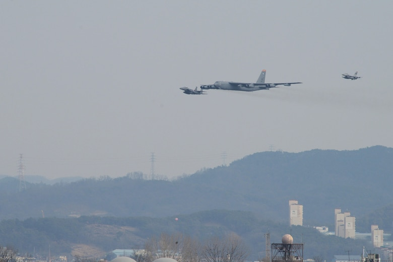 A U.S. Air Force B-52H  Stratofortress from Andersen Air Force Base, Guam, conducted a low-level flight in the vicinity of Osan, South Korea, in response to recent provocative action by North Korea Jan 10, 2016. The B-52 was joined by a ROKAF F-15  Slam Eagle and a U.S. Air Force F-16 Fighting Falcon.  The B-52 is a is a long-range, heavy bomber that can fly up to 50,000 feet and has the capability to carry 70,000 pounds of nuclear or precision guided conventional ordnance with worldwide precision navigation capability. (U.S. Air Force photo/Airman 1st Class Dillian Bamman)