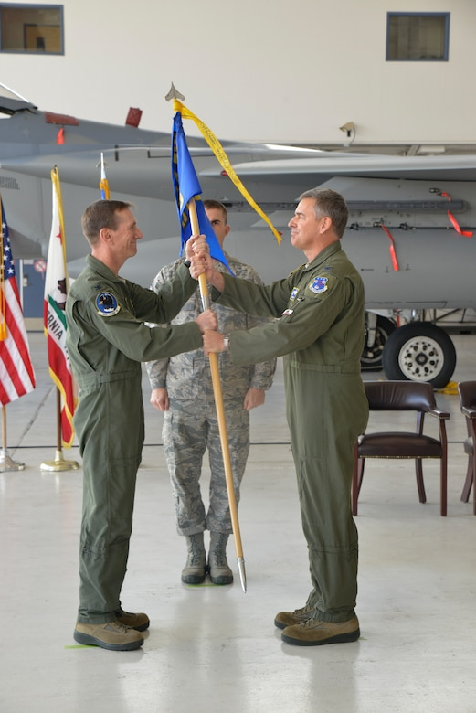 U.S. Air Force Col. John P. York, the outgoing 144th Operations Group commander, relinquishes command to U.S. Air Force Col. Steven J. Early. During the ceremony the recent accomplishments of the 144th Fighter Wing were discussed, the guidon was passed from the outgoing commander to the new commander and Col. Early's name was displayed on an F-15C Eagle. (Air National Guard Photographs by Master Sgt. David J. Loeffler)