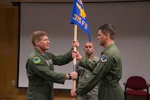 U.S. Air Force Maj. Daniel McGuire takes the 315th Fighter Squadron guide-on in an assumption of command ceremony, Vermont Air National Guard base, Jan. 10, 2016. McGuire will now be the commander of the 315th, an active-duty squadron housed at the base as part of the Total Force Integration program. The VTANG has been involved with the program for about 10 years. (U.S. Air National Guard photo by Airman 1st Class Jeffrey Tatro)