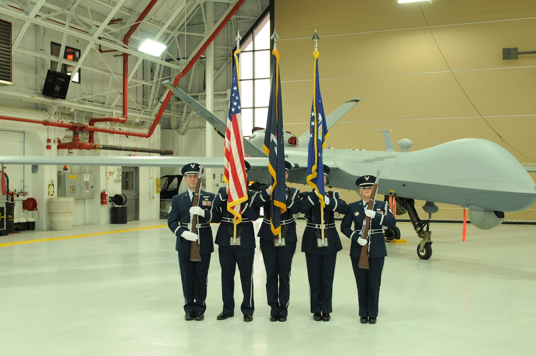 Members of the 174th Attack Wing's Honor Guard prepare to present the colors during the 152nd Air Operations Groups squadron activation and assumption of command ceremony held at Hancock Field Air National Guard Base Jan. 9. (U.S. Air National Guard photo by Tech. Sgt. Justin Huett/Released)