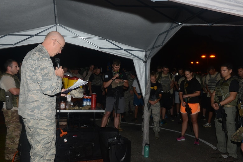 Lt. Col. Glenn Gresham, 36th Wing chaplain, leads service members in a prayer before a memorial 6K Jan. 8, 2016, at Andersen Air Force Base, Guam. Air Force Office of Special Investigations Det. 602, 36th Security Forces Squadron and 736th SFS hosted a 6K memorial run to honor the four AFOSI special agents and two security forces members who were killed by a motorcycle-borne improvised explosive device on Dec. 21, 2015, outside of Bagram Air Base, Afghanistan. (U.S. Air Force photo/Airman 1st Class Arielle Vasquez)