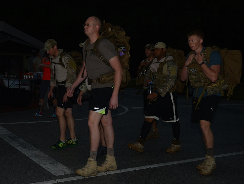 Service members conduct a ruck march during the 6K memorial run Jan. 8, 2016, at Andersen Air Force Base, Guam. Service members ran six kilometers to represent the six Airmen who were killed while conducting counter-threat operations outside of Bagram Air Base, Afghanistan. (U.S. Air Force photo/Airman 1st Class Arielle Vasquez)
