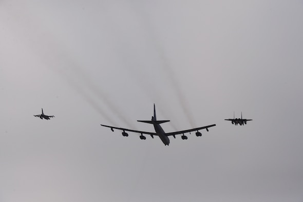 A U.S. Air Force B-52 Stratofortress from Andersen Air Force Base, Guam, conducted a low-level flight in the vicinity of Osan, South Korea, in response to recent provocative action by North Korea Jan. 10, 2016. The B-52 was joined by a South Korean F-15 Slam Eagle and a U.S. Air Force F-16 Fighting Falcon. The B-52 is a long-range, heavy bomber that can fly up to 50,000 feet and has the capability to carry 70,000 pounds of nuclear or precision guided conventional ordnance with worldwide precision navigation capability. (U.S. Air Force photo/Staff Sgt. Amber Grimm)