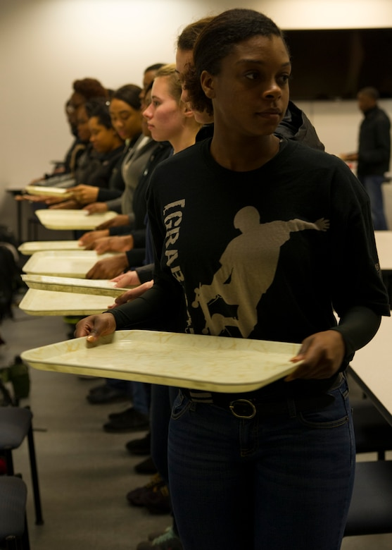 Trainees from the Development and Training Flight simulate basic training dining facility procedures January 9, 2016 at Joint Base Charleston. Tech. Sgt. Joshua Melton, the DTF program coordinator for the 315th Airlift Wing, teaches participants the basics of marching and Air Force protocol during their duty day.