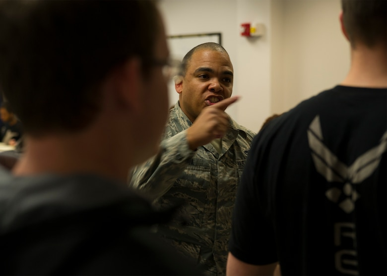 Airman 1st Class Ricky Roa, 38th Aerial Port Squadron at Joint Base Charleston, plays to role of an MTI at basic training for trainees in the Development and Training Flight January 9, 2016 at JB Charleston. Trainees were exposed to a typical dining facility experience in order to prepare them for BMT.