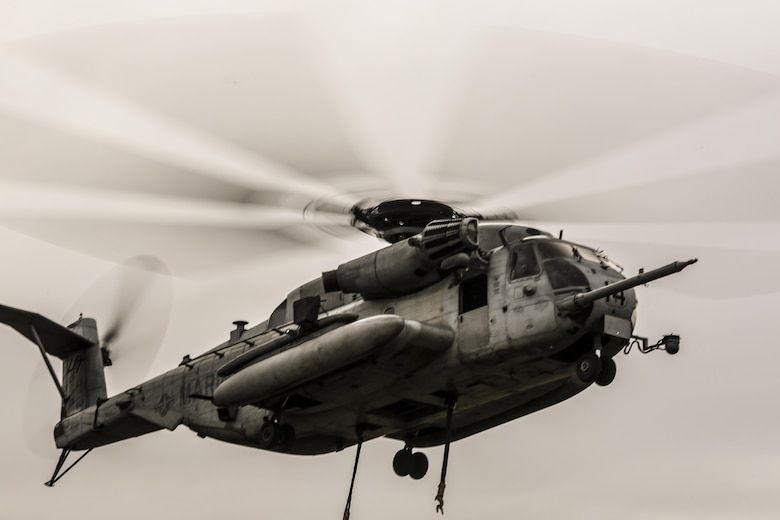 CH-53E Super Stallion hovers over the landing zone prior to conducting external lifts in conjunction with Combat Logistics Battalion 2 at Camp Lejeune, N.C., Jan. 6, 2016. The CH-53E is the go to aircraft in the Marine Corps for lifting heavy loads of cargo of up to 16 tons for 50 miles and back. (U.S. Marine Corps photo by Lance Cpl. Erick Galera/Released)