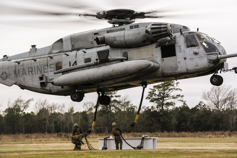 U.S. Marines with Combat Logistics Battalion 2 conduct external lifts in conjunction with Marine Heavy Helicopter Squadron 302 at Camp Lejeune, N.C., Jan. 6, 2016. The Marines with CLB 2 are responsible for directing the aircraft from the ground and attaching the load with the help from the crew chief, thus giving them the capability to move heavy loads in a combat environment. (U.S. Marine Corps photo by Lance Cpl. Erick Galera/Released)