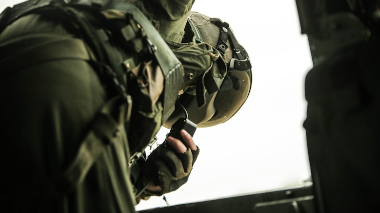 Cpl. Cody Vitols, a crew chief with Marine Heavy Helicopter Squadron 302, prepares to conduct external lifts in conjunction with Combat Logistics Battalion 2 at Marine Corps Base Camp Lejeune, N.C., Jan. 6, 2016. The crew chief's responsibilities when conducting external lifts are to direct the pilot and co-pilot as they attach the load to the CH-53E Super Stallion allowing the pilot to solely focus on maneuvering the aircraft.