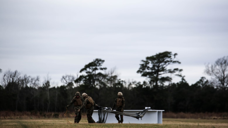 U.S. Marines with Combat Logistics Battalion 2 prepare to conduct external lifts in conjunction with Marine Heavy Helicopter Squadron 302 at Marine Corps Base Camp Lejeune, N.C., Jan. 6, 2016. The Marines with CLB-2 are responsible for directing the aircraft from the ground and attaching the load with help from the crew chief.