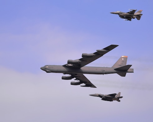 A U.S. Air Force B-52 Stratofortress from Andersen Air Force Base, Guam, conducted a low-level flight in the vicinity of Osan Air Base, South Korea, in response to recent provocative action by North Korea Jan. 10, 2016. The B-52 was joined by a ROKAF F-15K Slam Eagle and a U.S. Air Force F-16 Fighting Falcon. The B-52 is a is a long-range, heavy bomber that can fly up to 50,000 feet and has the capability to carry 70,000 pounds of nuclear or precision guided conventional ordnance with worldwide precision navigation capability. (U.S. Air Force photo/Staff Sgt. Benjamin Sutton)