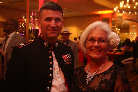 Col. Jeffrey Smitherman, Commanding Officer of the 6th Marine Corps District, poses with Connie Skinner, assistant to the president of the TaxSlayer Bowl, during the New Year's Eve Gala Dec. 31, 2015. The New Year's Eve Gala marks the beginning of the annual TaxSlayer Bowl that will take place on Jan. 2, 2016, at EverBank Field in Jacksonville, Fla. is the commanding officer of the 6th Marine Corps District, Parris Island, South Carolina. (Official Marine Corps photo by Cpl. John-Paul Imbody)