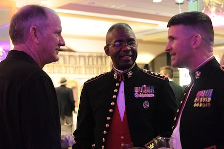 Vincent McCormack, Lt. Gen. Ronald L. Bailey and Col. Jeffrey Smitherman chat at the New Year's Eve gala Dec. 31, 2015, at the Hyatt Regency Hotel in Jacksonville, Fla. The gala is an opportunity for Marine officers to meet with key influencers of the upcoming TaxSlayer Bowl at EverBank Field in Jacksonville, Fla. McCormack is the immediate past chairman of the TaxSlayer Bowl. Bailey is the Deputy Commandant Plans, Policies, and Operations, Headquarters Marine Corps. Smitherman is the commanding officer of the 6th Marine Corps Recruiting District, Parris Island, South Carolina. (Official Marine Corps photo by Cpl. Diamond N. Peden/Released)