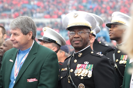 Lt. Gen. Ronald L. Bailey watches the coin tossing event before the TaxSlayer Bowl Jan. 2, 2016, at EverBank Field in Jacksonville, Fla. The 2016 TaxSlayer Bowl featured the Georgia Bulldogs and the Penn State Nittany Lions. Bailey is the Deputy Commandant Plans, Policies, and Operations of Headquarters Marine Corps. Smitherman is the Commanding Officer of the 6th Marine Corps Recruiting District, Parris Island, South Carolina. (Official Marine Corps photo by Cpl. Diamond N. Peden/Released)