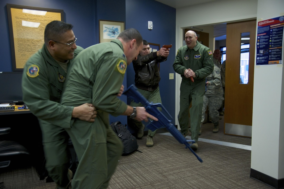 Reservists from the 446th Airlift Wing practice both tactical entry into a room and response to an invader as part of expeditionary active shooter training taught by the 446th Security Forces Squadron Jan. 10, 2016. (U.S. Air Force Reserve photo by Staff Sgt. Madelyn McCullough)