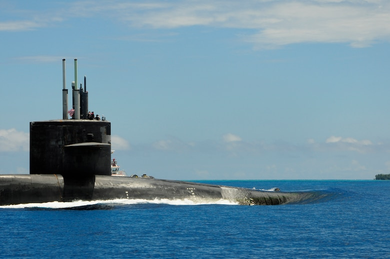 160107-N-PN275-020 DIEGO GARCIA, British Indian Ocean Territory (Jan. 7, 2016) Guided-missile submarine USS Florida (SSGN 728) pulls into Diego Garcia to moor alongside submarine tender USS Emory S. Land (AS 39). Emory S. Land is a forward deployed expeditionary submarine tender on an extended deployment conducting coordinated tended moorings and afloat maintenance in the U.S. 5th and 7th Fleet areas of operations. (U.S. Navy photo by Mass Communication Specialist 3rd Class Zachary A. Kreitzer/Released)