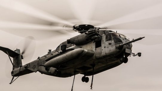CH-53E Super Stallion hovers over the landing zone prior to conducting external lifts in conjunction with Combat Logistics Battalion 2 at Marine Corps Base Camp Lejeune, N.C., Jan. 6, 2016. The CH-53E is the go to aircraft in the Marine Corps for lifting heavy loads of cargo of up to 16 tons for 50 miles and back.