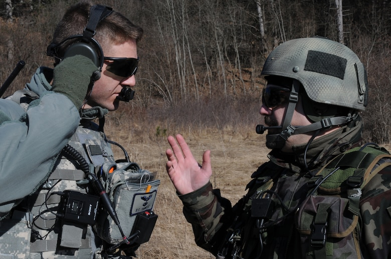 Maj. Bryan Trinkle, 8th Air Operations Support Squadron operations officer and joint terminal attack controller, discusses close air support training scenerios with Slovenian army Sgt. 1st Class Sergej Savov, 1st Brigade tactical air control party leader, during a NATO coalition combat capability training exercise at Pocek Range in Postojna, Slovenia, Feb. 2, 2011. The exercise consisted of close air support training between Aviano Air Base, Italy, and Slovenian army joint terminal attacks controllers and tactical air control party operators as well as Slovenian PC-9M aircraft.(U.S. Air Force Photo/ Staff Sgt. Nadine Y. Barclay)