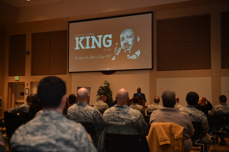 Tech. Sgt. Joel Johnson, Air Reserve Personnel Center education services specialist, speaks during the Martin Luther King, Jr. Day ceremony at the Leadership Development Center Jan. 11, 2016, on Buckley Air Force Base, Colo. The ceremony featured readings of Dr. King's speeches, videos, and southern style food. (U.S. Air Force photo by Staff Sgt. Darren Scott/Released)