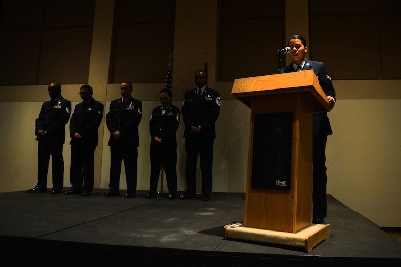 Airman 1st Class Alyssa Duprey, 460th Space Wing Public Affairs broadcast journalist, reads part of a speech by Dr. Martin Luther King, Jr. as part of the Leadership Development Center Jan. 11, 2016, on Buckley Air Force Base, Colo. The ceremony featured readings of Dr. King's speeches, videos, and southern style food. (U.S. Air Force photo by Staff Sgt. Darren Scott/Released)