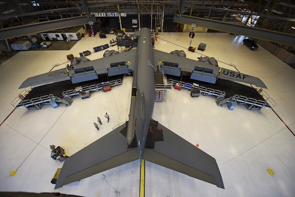 The 92nd and 141st Maintenance Squadrons and the 92nd Aircraft Maintenance Squadron and work on the last Periodic Inspection of the year Dec. 9, 2015, at Fairchild Air Force Base, Wash. During the initial phase of PE, panels are removed from the jet and Airmen look for discrepancies. Approximately 1,200 maintenance actions are found and completed throughout every PE. (U.S. Air Force photo/Airman 1st Class Mackenzie Richardson)