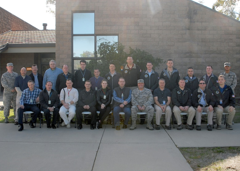 A Strategic Arms Reduction Treaty team from Russia poses for a group photo with members of Vandenberg Air Force Base after completing an on-site verification in compliance with START requirements, Dec. 6, 2015, Vandenberg Air Force Base. START is a bi-lateral treaty between the Russian Federation and the United States, each nation gets 18 inspection quotas per treaty year to continue the strategic arms control process. (U.S. Air Force photo by Senior Airman Kyla Gifford/Released)
