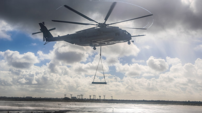 A CH-53E Super Stallion with Marine Heavy Helicopter Squadron 465 carries a simulated cargo load of 6,200 pounds aboard Marine Corps Air Station Miramar, Calif., Jan. 7. Marines with HMH-465 and Combat Logistics Battalion 11 practiced daytime external lift training to prepare for deliveries during deployments.