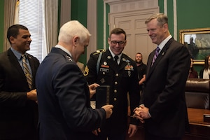 Maj. Gen. L Scott Rice, the adjutant general, presents the Soldiers Medal to Staff Sgt. Geoffrey Curtis. Curtis was awarded the medal by Massachusetts Governor Charlie Baker during a ceremony at the state house January 11, 2016. Curtis' award is in recognition of his swift response and heroic actions immediately following the Boston Marathon bombings in 2013. (Photo by Sgt. Alfred Tripolone)