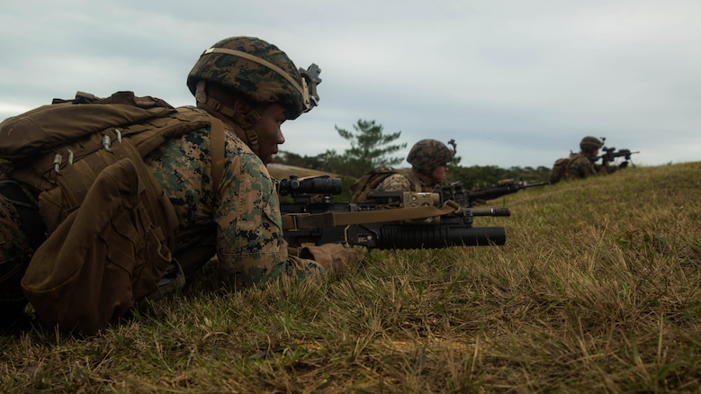 Marines get set to perform buddy rushes during squad attack training on Camp Schwab in Okinawa, Japan, Jan. 6, 2016. Marines with Bravo Company, Battalion Landing Team 1st Battalion, 5th Marines, 31st Marine Expeditionary Unit, conducted squad attack training in preparation for the MEU's upcoming spring deployment.