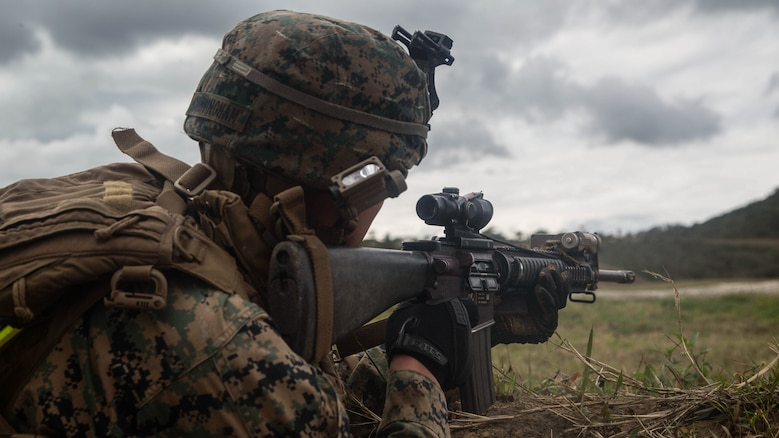 Lance Cpl. Jacob Cunningham fires at a target during squad attack training on Camp Schwab in Okinawa, Japan, Jan. 6, 2016. The Marines of Bravo Company, Battalion Landing Team 1st Battalion, 5th Marines, 31st Marine Expeditionary Unit, serve as the MEU's boat company, specialized in amphibious raids using Combat Rubber Raiding Craft. Cunningham is a rifleman with Bravo Co., BLT 1/5, 31st MEU. (U.S. Marine Corps photo by Cpl. Samantha Villarreal/Released)