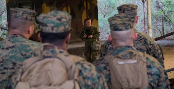 Sgt. Caleb Renner, the chief chemical, biological, radiological, and nuclear instructor with II MEF Headquarters Group, gives an hour-long class on how to properly wear and function in a M50 gas mask at Camp Lejeune, N.C., Jan. 8. The chamber is a routine exercise to ensure the durability of each Marine's gear while exposed to chlorobenzylidene malononitrile, or CS gas, which is a bi-annual qualification requirement for Marines. (U.S. Marine Corps photo by Lance Cpl. Preston McDonald/Released)