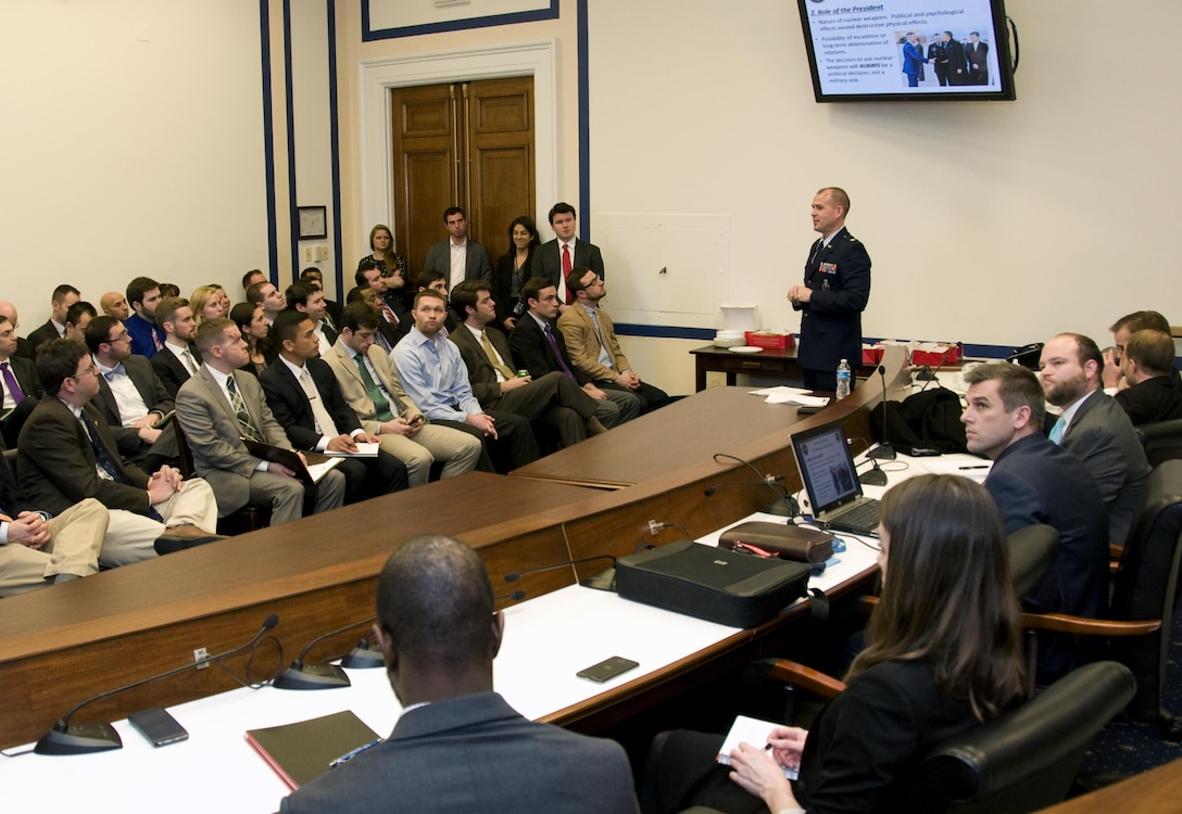 Maj. Stephen Bonin, a senior emergency actions officer with the National Military Command Center, briefs policymakers on the nuclear triad system during an Air Force 101 session at the Rayburn House Office Building in Washington, D.C., Jan. 11, 2015. The bi-monthly sessions educate policymakers on Air Force matters to help them make informed decisions. (U.S. Air Force photo/Sean Kimmons)