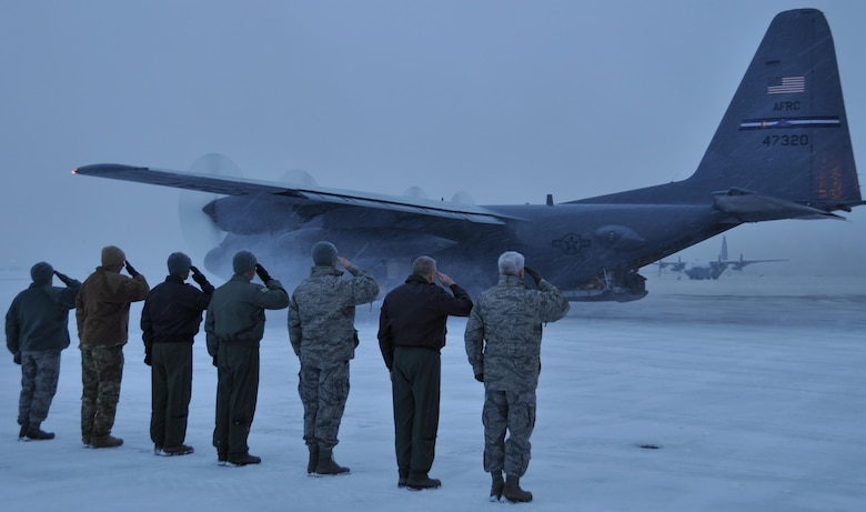 PETERSON AIR FORCE BASE, Colo. – Senior leaders from the Air Force Reserve Command's 302nd Airlift Wing salute a C-130H aircraft departing Peterson Air Force Base's flightline.  Approximately 150 Air Force Reservists and four C-130s from the 302nd Airlift Wing are serving on a four-month deployment to Southwest Asia in support of Operation Freedom's Sentinel.  The aircraft, aircrews and support personnel will provide airlift, airdrop and aeromedical evacuation support to operations throughout the U.S. Central Command Area of Responsibility. (U.S. Air Force photo/Daniel Butterfield)