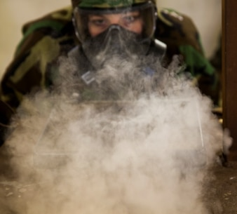 Lance Cpl. Jamie Roper, a chemical, biological, radiological, and nuclear Marine with Headquarters Company, 2nd Marine Logistics Group, disperses chlorobenzylidene malononitrile, or CS gas, in preparation for gas chamber bi-annual qualification at Camp Lejeune, N.C., Jan.8.  The chamber is a routine exercise to ensure the durability of each Marine's gear while exposed to CS gas. (U.S. Marine Corps photo by Lance Cpl. Preston McDonald/Released)